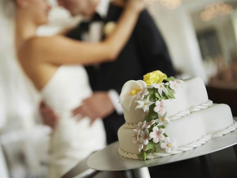 Couple and wedding cake