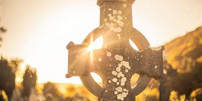 Sun through Celtic Cross